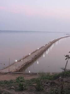 Lights of Kampong Cham's P'Dar (Bamboo Bridge) at dusk.