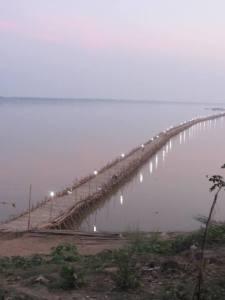 Lights of Kampong Cham's P'Dar (Bamboo Bridge) at dusk.