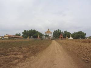 Krong Wat, Kampong Cham.  School building to the left, ornate graves and temple central