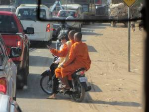 Monks on motorbikes are a common sight in Cambodia