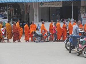Monks collecting alms in Kampong Cham today