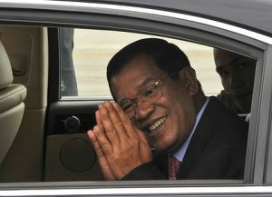 Prime Minister Hun Sen greets the press with a Sampeah gesture