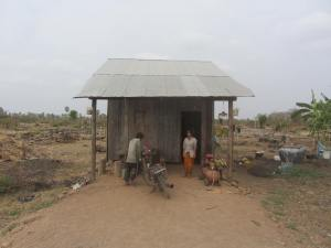 A wooden hut in the dust, rural Kampong Cham